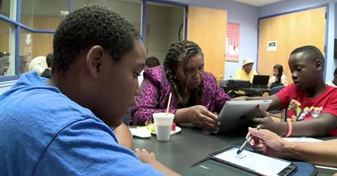 Teens help seniors bridge technology gap